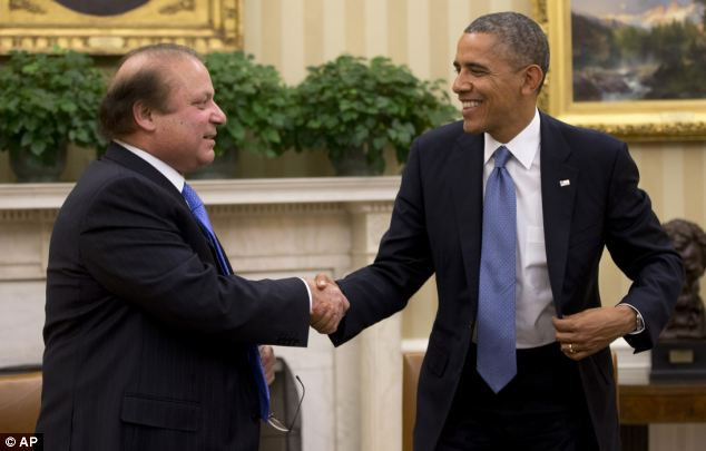Back on the rocks: Pakistan Prime Minister Nawaz Sharif holding talks with with President Obama last month, the Pakistani government has accused the US of trying to derail peace talks with the Taliban