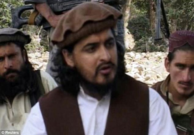 Killed: Pakistani Taliban chief Hakimullah Mehsud, pictured sitting with other militants in South Waziristan in 2009, was killed in an American drone strike yesterday