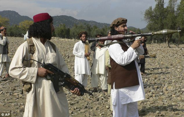 Chief: Mehsud pictured holding a rocket launcher with his comrades in South Waziristan along the Afghan border in 2009