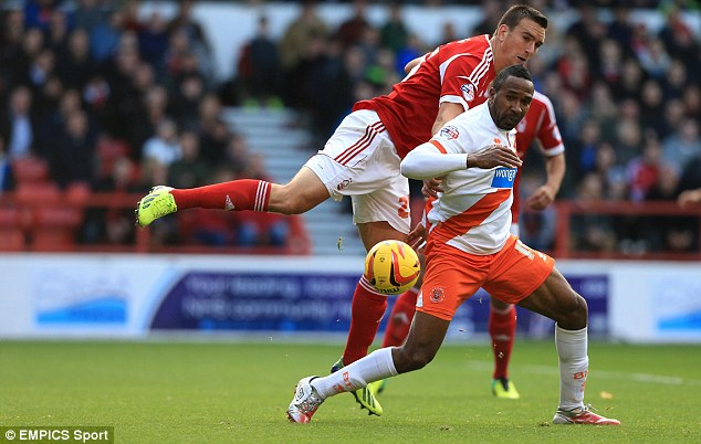 Tussle: Nottingham Forest's Jack Hobbs and Blackpool's Ricardo Fuller get to know one another