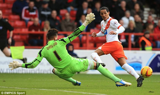 Nearly the saviour: Nottingham Forest's Karl Darlow saves from Blackpool's Ince