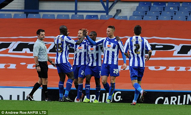 All smiles: Sheffield Wednesday players celebrate Connor Wickham's goal