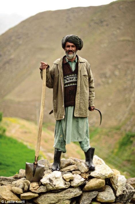 Abdul Hafiz stands holding a shovel and a sickle. His story is just one of those detailed in the new exhibition