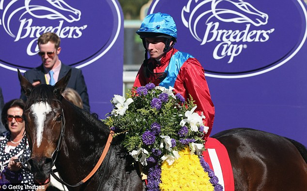 Winning feeling: Ryan Moore led Dank to win the Filly & Mares Turf at the Breeders' Cup