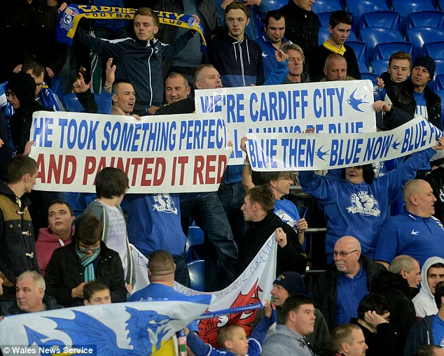 Protest: Cardiff fans demonstrate their anger at Malaysian club owner Vincent Tan following their 1-0 win over Swansea