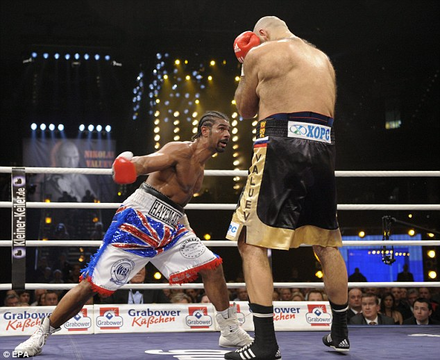 Size issue: Valuev dwarfed the not insignificantly sized Haye in their heavyweight title bout in 2009