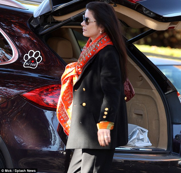 Retail therapy: The mother-of-two looked stylish in a black jacket and orange scarf