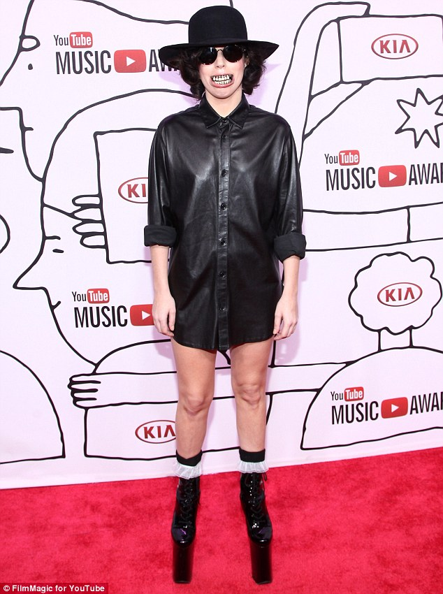 Back to wacky: Gaga slipped on a very funny looking grill for the YouTube Music Awards on Sunday evening in New York