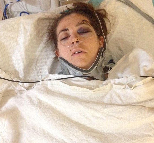 New mother: Rachel Poole in hospital in the aftermath of her attack by Moss in October that left her blind in one eye and with multiple stab wounds on her torso and back