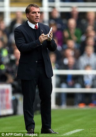 Challenge: Rogers during a match between Newcastle United and Liverpool