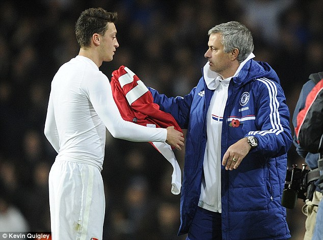 Impressed: Mourinho (right) believes Ozil made a difference to Arsenal