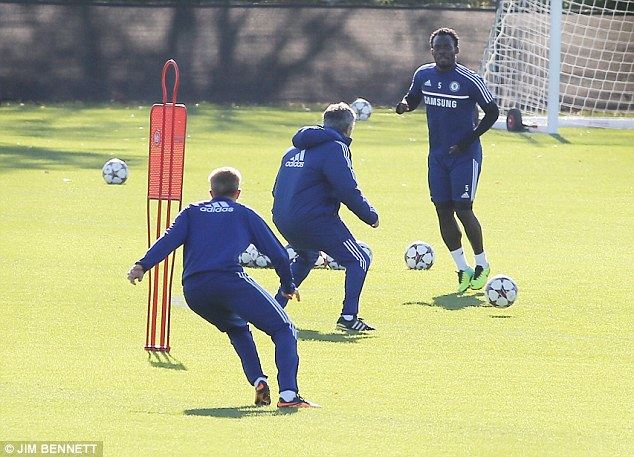 Involved: Mourinho (middle) takes part in the Chelsea first team training