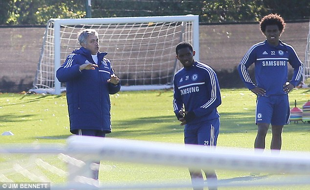 Man with a plan: Will Mourinho (left) pick the right 11 players this week?