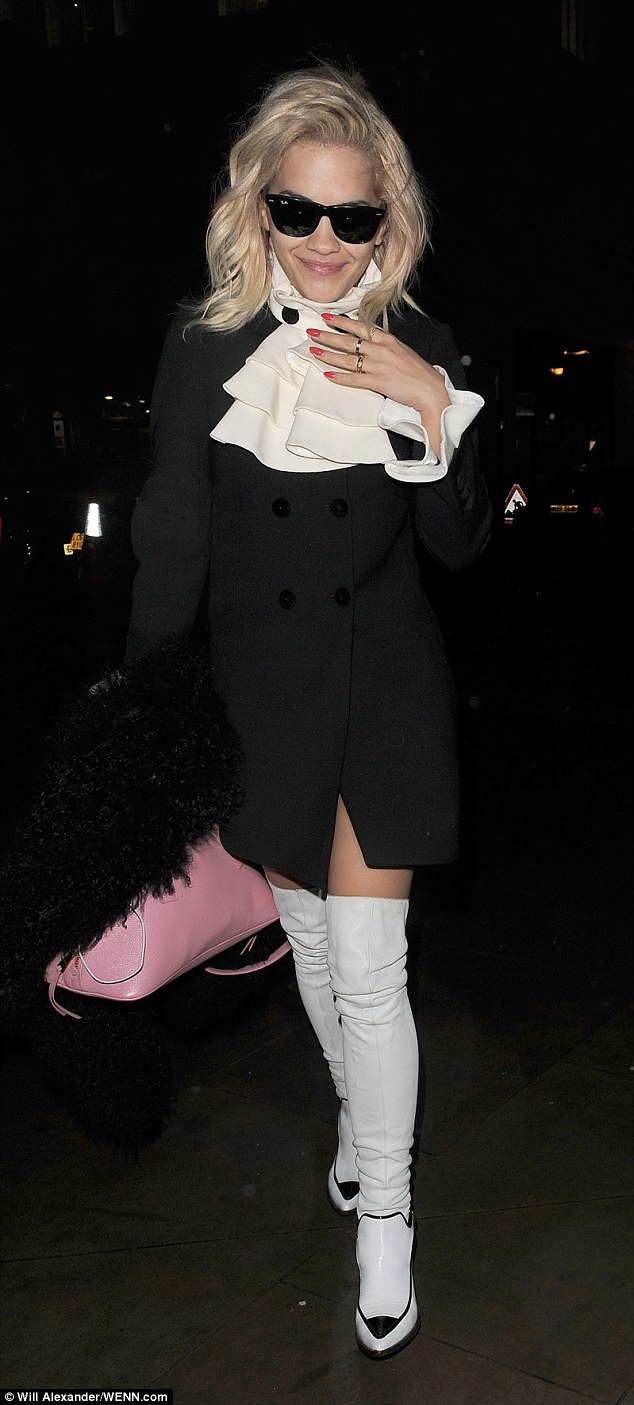 Morning person: Rita looked smiley and well put together  in her eccentric get up, which she accessorised with a pastel pink bowling bag and furry jacket