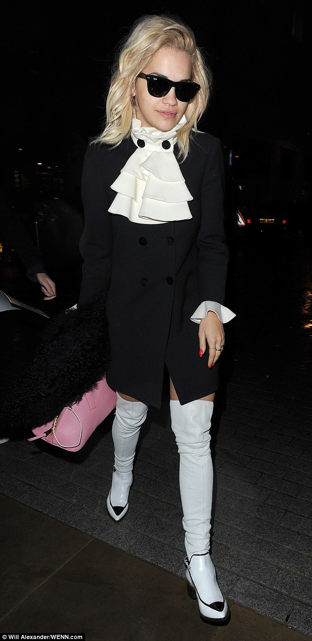 Looking dapper: Rita Ora arrived at the Radio 1 studios on Monday in another eclectic outfit choice to co-host the Radio 1 Breakfast Show with Nick Grimshaw