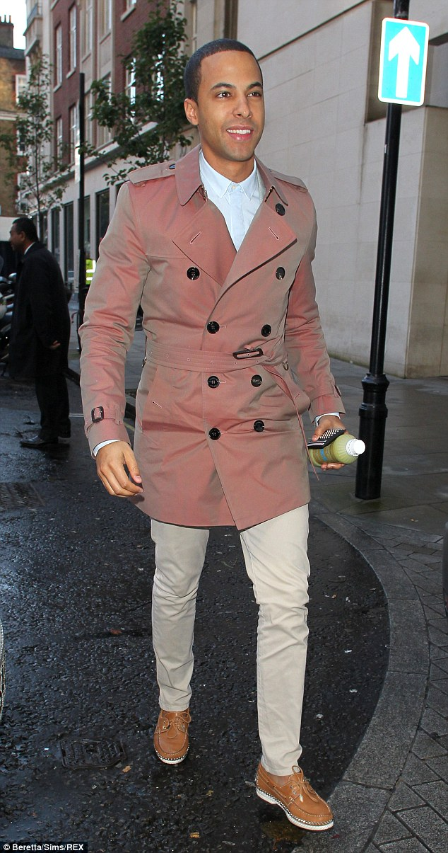 Radio ready: Marvin Humes arrived at the BBC Radio One studios looking dapper in a smart coat, chinos and brown loafers and carried a healthy green juice