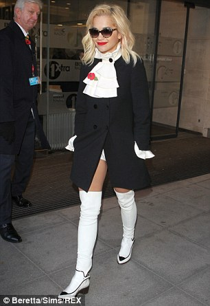 Yeah baby yeah: Singer Rita looks just like Austin Powers on her visit to the BBC Radio One studios in the early hours of Monday morning