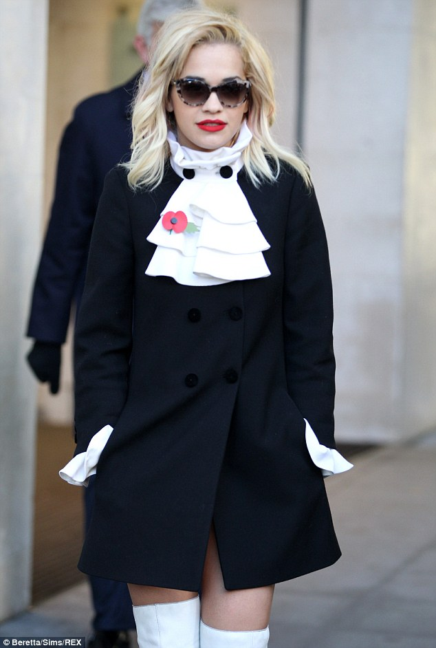 Eye spy a trend: The singer actually pulls off the eccentric ruffled collar against the odds