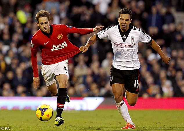 Fulham's Kieran Richardson (right) and Manchester United's Adnan Januzaj battle for the ball