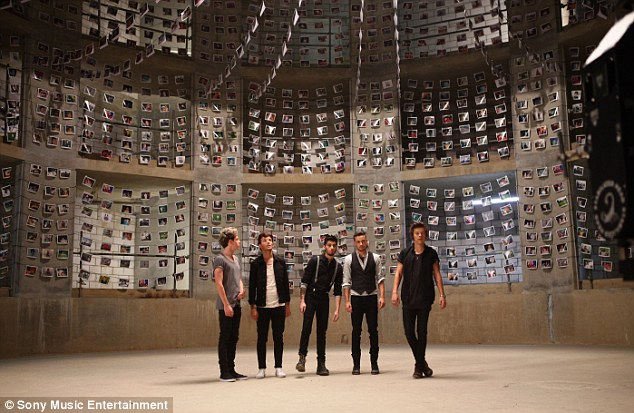 Memories: The boys pose in front of a collection of family photos