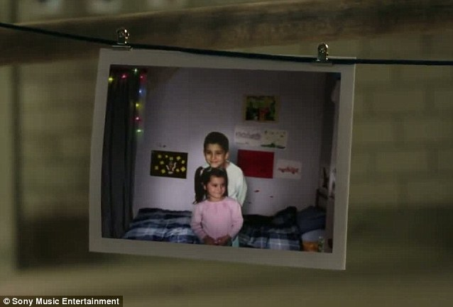Too cute: The brother and sister recreate the former childhood photo