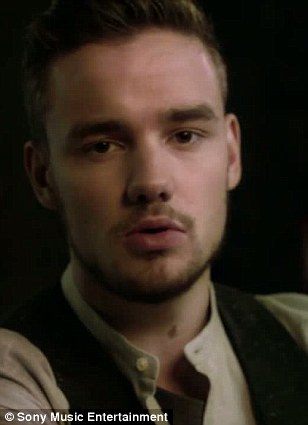 Liam Payne sings in the Story Of My Life video