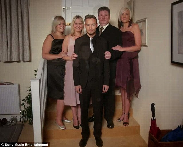 The Paynes: Liam poses with his two sisters, mother and father in their home