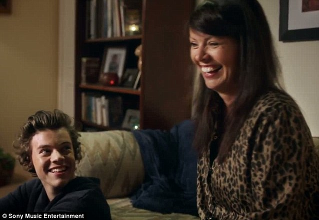 Mother and son: Harry Styles and his mum share a giggle during one candid moment in the video