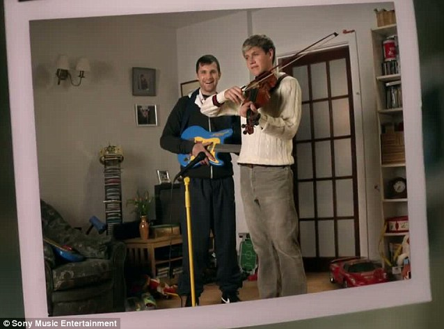 Brotherly love: Niall Horan and Greg play the violin and toy guitar for their funny snap