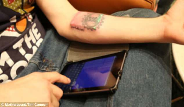 German-based biohacker Tim Cannon fitted the biometric sensor, pictured, under the skin on his forearm, which connects by Bluetooth to an Android tablet, pictured.