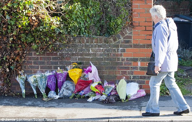 Tributes: Friends have left bunches of flowers at the scene of the two girls' death, and have gathered to remember the teenagers