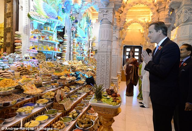 David Cameron in front of some of the thousands of sweets that are shared during the festival