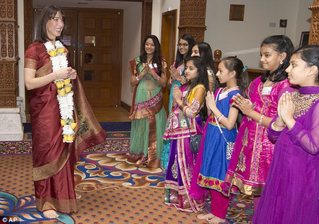 Samantha Cameron wife of Britain's Prime Minister David Cameron, greets a group of young women during the visit