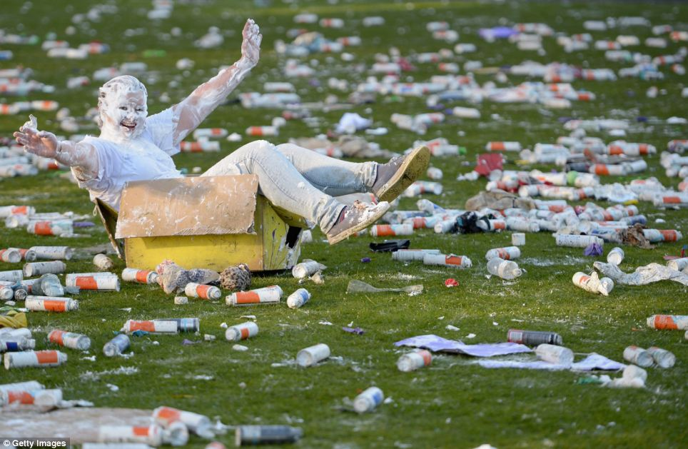 Party: A lone student sits in a cardboard box surrounded by empty cans of shaving foam following the annual event