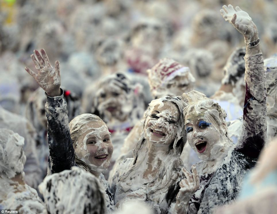 Welcome: Students enjoy the annual foam party, part of a traditional weekend designed to make them feel more at home at the university