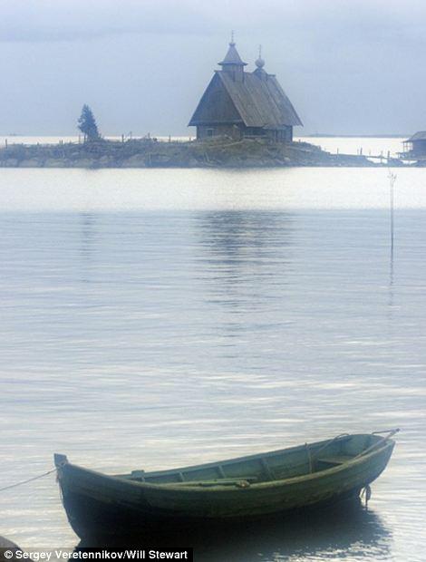 Serene images of Russian Village-Boat-credit S. Veretennikoveast2west news,queries Will Stewart 007 985 998 94 00.jpg
