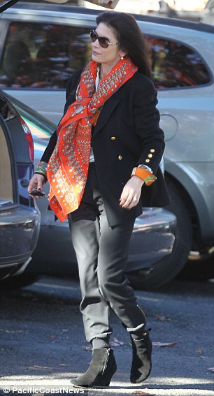 The mother-of-two wore stylish wedged boots