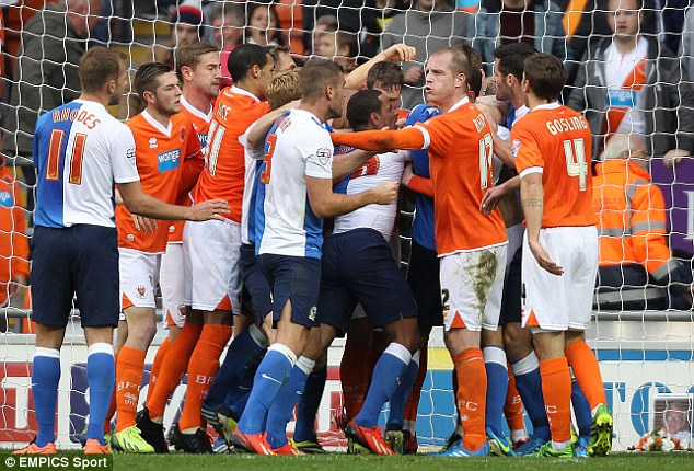 Feisty finish: Blackpool and Blackburn players tussle near the end of their 2-2 draw at Bloomfield Road