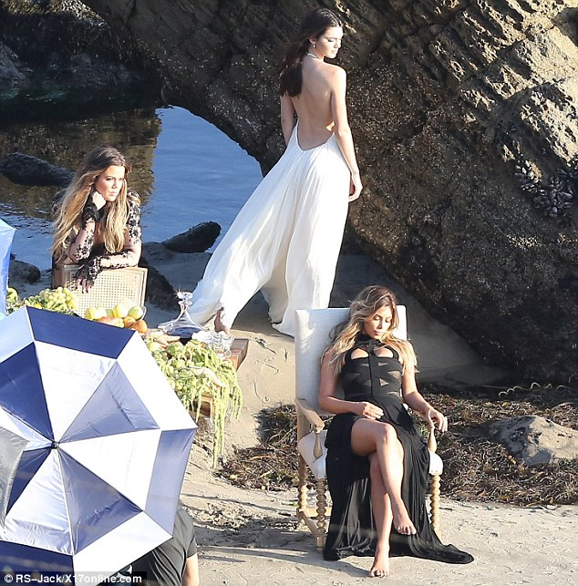 Joint effort: Kim's sister Khloe Kardashian and Kendall Jenner were seen posing in the background of one shot