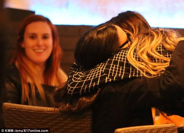 Demi hugs