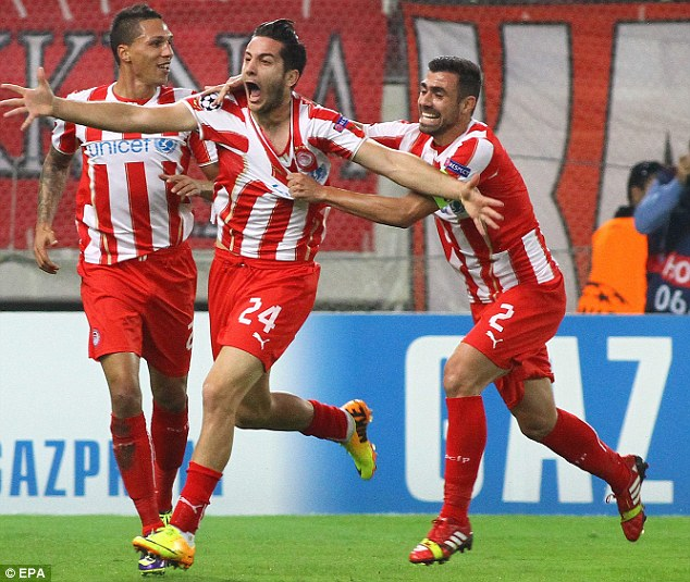 Ecstatic: Defender Kostas Manolas (centre) celebrates after putting Olympiakos ahead at home to Benfica