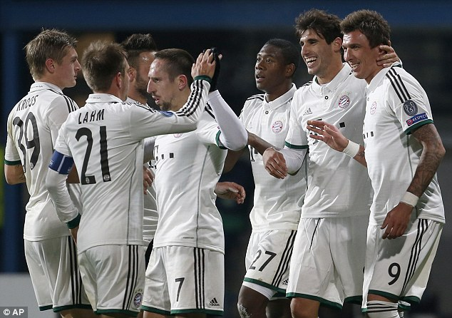Through: Holders Bayern Muncih progressed to the knockout stages thanks to Mario Mandzukic's goal (right)
