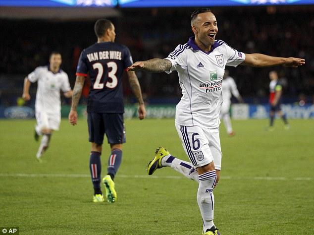 Lead: Midfielder Demy De Zeeuw wheels away to celebrate having put Anderlecht ahead in the French capital