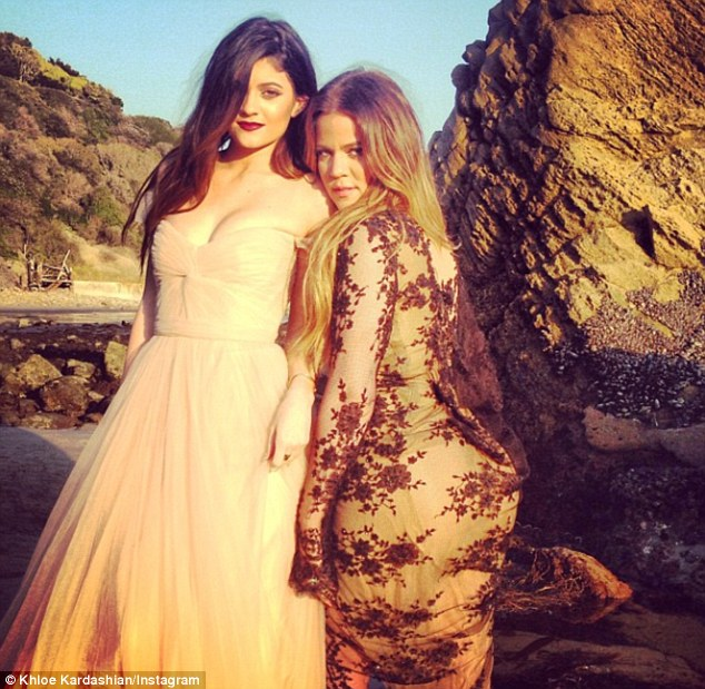 The clan's all here: Kylie wore another revealing dress as she posed with her sister Khloe Kardashian