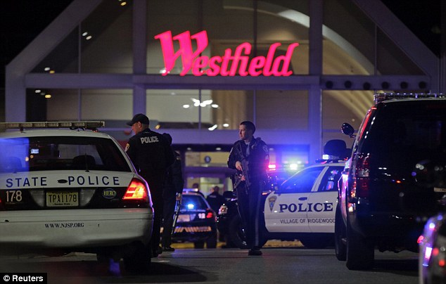 Police secure the area after reports that a gunman fired shots at the Garden State Plaza mall in Paramus, New Jersey