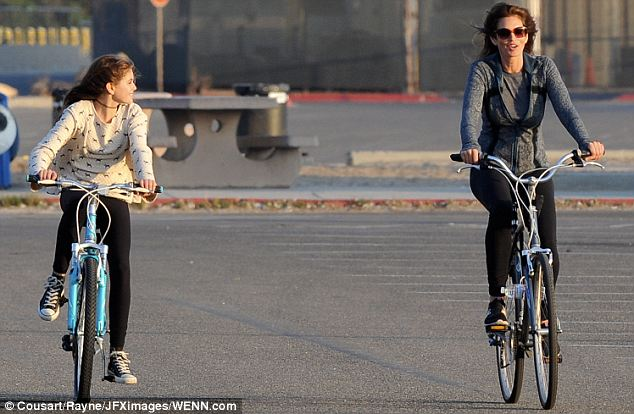 Freewheelin': The pair both smiled broadly as they continued their ride side by side