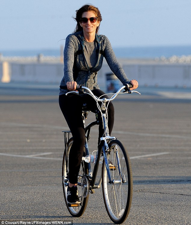 Biker babe: The actress looked beautiful in black leggings that showed off her slender pins paired with a grey cardigan and matching grey T-shirt