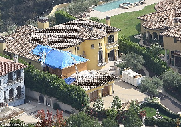 Still not quite ready! Kim and Kanye's Bel Air mansion is still being worked on before they move in with baby daughter North