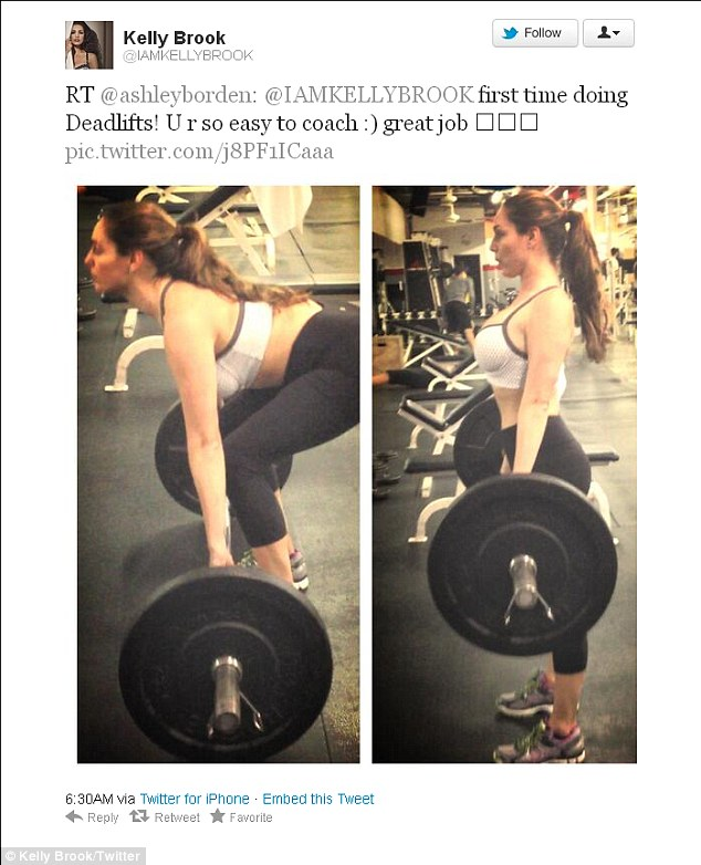 She works at it: Kelly Brook's personal trainer Ashley Borden tweeted this pic of her new client in the gym doing dead weights