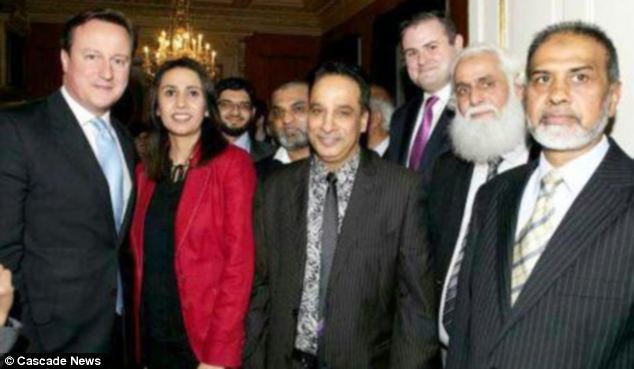In attendance: Abdul Aziz, pictured centre, poses with PM David Cameron at 10 Downing Street